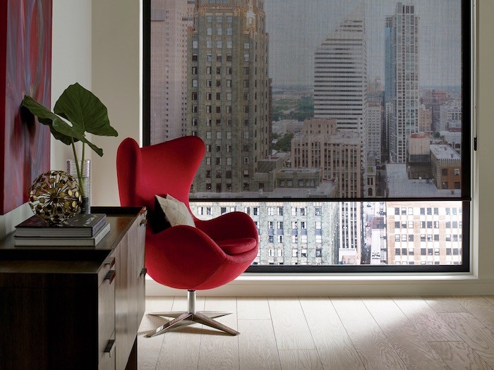 A living room with a red side chair.